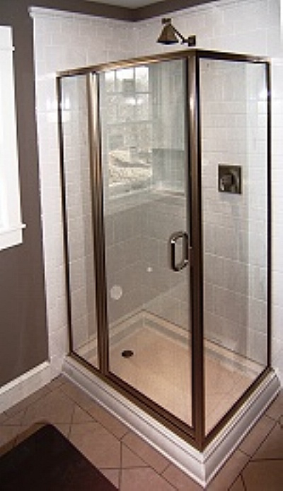 showroom display at northport bath neoangle enclosure brush ed nickel trim with rain glass we make these semicuston en closures at our shop in