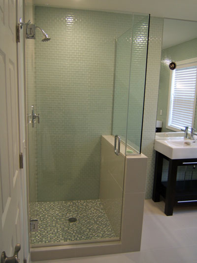 Three panel and up frameless shower doors for Glass wall panels bathroom